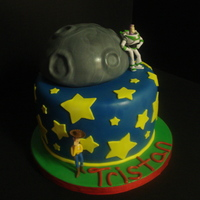 "Toy Story Birthday Cake Half ball pan moon on top of an 8"" round, covered in fondant. The red ribbon matched the candles that were later placed on the cake -..."