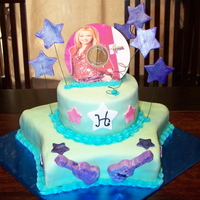 Another Hannah Montana Cake stars are gumpaste. Chocolate cake covered in MMF. Guitars are made from candy melts