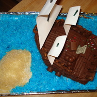 Pirate Ship Cake Made of chocolate cake with chocolate frosting. 2 9 inch round cakes make the ship. The extra from the bottom makes the island. Island is...