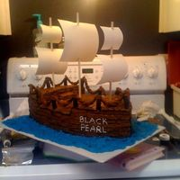 Pirate Ship   This is all buttercream except for the rope and pedestals holding the rope.