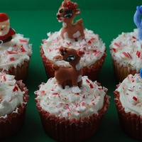 Rudolph And Candy Cane Cupcakes Some fun and basic cupcakes for Christmas featuring the stars of Rudolph the Red Nosed Reindeer and crushed candy cane.