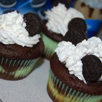 Mini Oreo Surprise Cupcakes Devils food cake w/ a mini oreo and cream cheese filling inside. Topped with cool whip and more mini oreos for an extra chocolately...