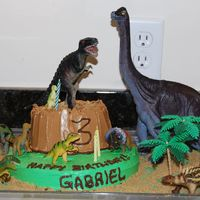 Dinosaur Mountain This is a two tier funfetti cake made for my son, Gabriel's 3rd Birthday today, June 18th. He is a true dinosaur fanatic so he was...