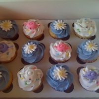 Tea Party Vanilla cupcakes with bubblegum buttercream. MMF teapots, royal icing daisies.