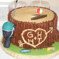 Stump Grooms Cake Chocolate buttercream with fondant accents. Lures made out of fondant and handpainted. Reel made out of rkt covered in fondant (actual pole...