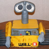 Wall-E My boys birthdays are only a week and half apart. So this year since they both love WALL-E I did one cake for them both (one is 2 and one...