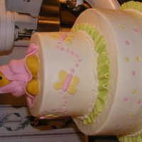 Pooh Shower Cake Iced in buttercream with fondant accents. First time doing ruffles. Needed two sets of hands:)