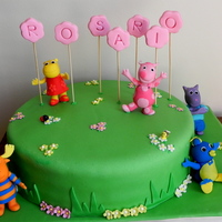 Backyardigans Cake vanilla cake filled with dulce de leche cover in fondant. And the figures are all made in gum paste