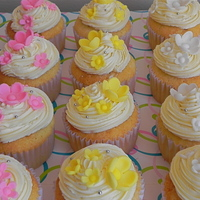 Flower Cupcakes   vanilla cupcakes filling with dulce de leche and italian meringue buttercream for the frosting. Gumpaste flowers