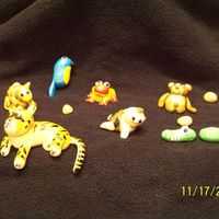 Animals For Jungle/diego Cake made animals for jungle cake then turned into diego cakeall animals are made from fondantfrog, graffee, monkey, elephant, bird, alligator,...