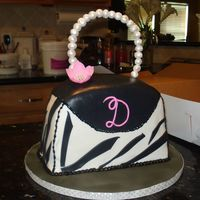 Zebra Print Bag Strawberry cake with cream cheese filling. Pearls made of fondant.