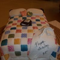 Patchwork Quilt Birthday Cake fondant covered with patchwork quilt cutters. Hand painted squares.