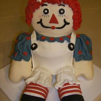 Raggedy Ann Raggedy Ann cake with rkt arms and legs and face