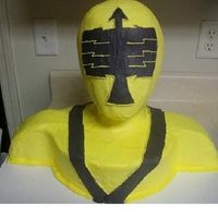 Power_Ranger.jpg   Power Ranger with wig head. Buttercream with fondant accents. Thank you to Nicole for her help:)