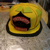 Fire Helmet 3D  This cake was a donation for a charity event. Used my roommate's helmet, as well as a few from on here. Fondant with buttercream...