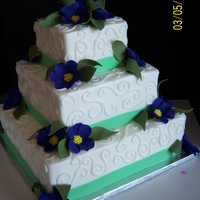 Square Bride fondant flowers were a deep purple, when I take pics of purple it looks blue. If anyone has tips for that I would appreciate them. anyhow,...