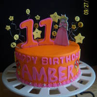"Amber's 11Th Birthday my daughter designed her own cake this year. she picked the colors and cut out the ""happy birthday""letters, stars and coins. I..."