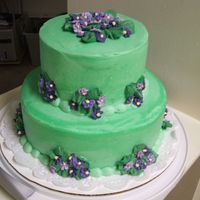 Green Violet I made the violets in 3 shades with royal icing on parchment paper. Then placed on the cake once dry.