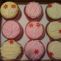 Cupcakes Cream cheese based white chocolate cupcakes with white chocolate betttercream and fondant.