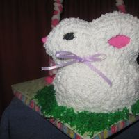 Easter Bunny Pound cake with buttercreme icing. The grass is made from dyed coconut.