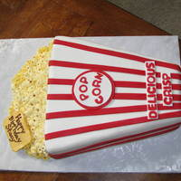 Popcorn Birthday Cake iced in buttercream with fondant decorations. Popcorn is made from buttercream.