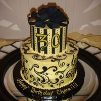 "Yellow And Black Birthday Cake 2 tiered cake (6"" and 10"") The top was vanilla cake with one layer of lemon curd and 2 cream cheese and the bottom was red velvet..."