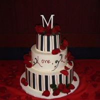 Black, White & Red Wedding Cake This cake was for a fun couple. The top was red velvet, the 2nd was black forrest and the bottom was vanilla with fresh strawberries. I...