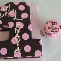 "Carved 1 For First Birthday And Smash Cake I carved this cake from a 1/2 sheet. It is finished in chocolate ganache with pink fondant circles. The smash cake is a 4"" round..."