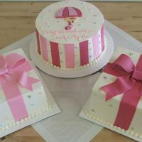 "Baby Shower Presents The 9"" round was vanilla cake with 2 layers of fresh strawberries and 1 layer of vanilla pastry cream. One of the square cakes was..."