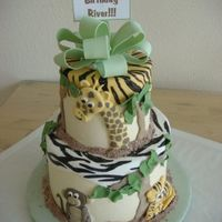 "Jungle 2 Tiered Cake This is a two-tiered (5-8) finished in IMBC with added fondant decorations. The ""box tops"" were cut fondant pieces laid over the..."