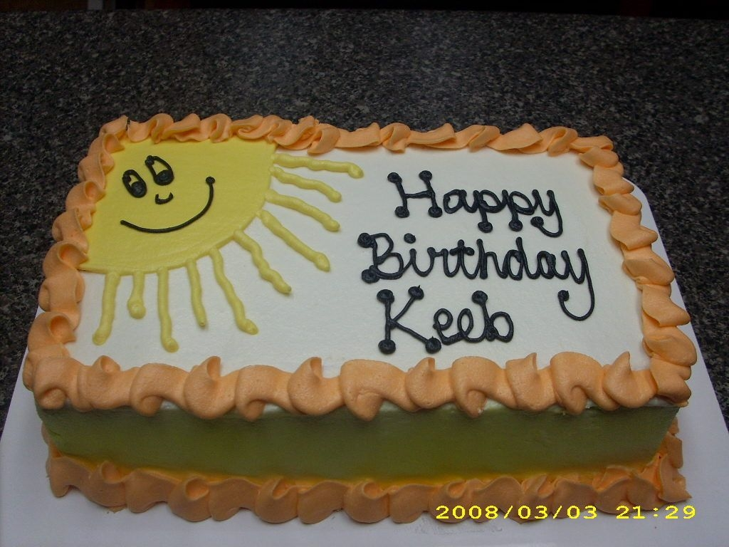 Sunshine Cake Hubby's b-day cake. Airbrushed yellow on the side. Hubby always draws a sun in our cards and letters, so I put this sun on his cake.