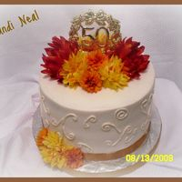 "50Th Anniversary Cake 50th Anniversary Cake8"" Round Chocolate with Buttercream IcingPlastic Topper with Silk Flowers and Ribbon( I did this cake earlier in..."