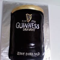 Guinness Cake This is a vanilla cake with strawberries and cream buttercream. The cake is covered in a chocolate fondant. The lettering is cut out of...