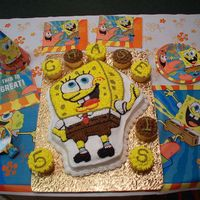 Sponge Bob Square Pants Cake  I made this for my grandson, Chase. There wasn't room to write his name and age on the cake so I made cupcakes and put it on them....