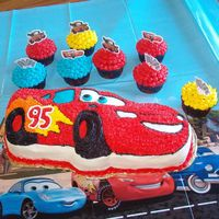 Cars Birthday Cake  I made this for my grandson's birthday. It's all buttercream icing and chocolate cake. I also made cupcakes to accent and put...
