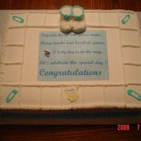 God Bless A Newborn  Made this 11x15 1/2 and 1/2 with BC frosting. Booties are marshmellows. I took the blue plaid and saying from her invitation. The cake was...