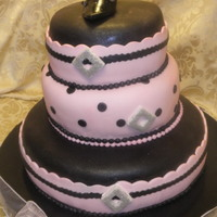 Pink & Black Stilletto Cake Chocolate with Raspberry Filling, Chocolate with Almond Cream Cheese Filling, and Lemon Poppy seed with Almond Cream Cheese Filling. All...
