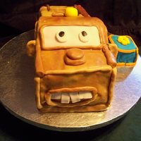 Tow Mater Yellow cake, fondant covered. Smash block cake same, yellow cake, fondant covered.