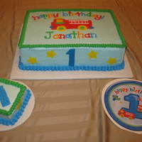 Fun At One Birthday Cake This is a french vanilla cake with half strawberry and half lemon filling - BC icing with fondant accents - made to match plates and...