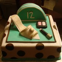 12Th Birthday  I had fun making this cake. It was for a girls 12th birthday. The spots, makeup, shoe and makeup bag are made from fondant. I totally...
