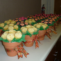 25 Cupcake Bouquets I made 25 cupcake bouquets for my annual Master Gardener luncheon. I made three flavors-- Guinness stout w/brown sugar meringue buttercream...