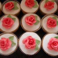Roses   cupcakes to go with flower and lace cookies for engagement. made to match serviettes