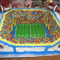 Football Stadium Chocolate cake with buttercream icing covered in fondant and I used another CC's pattern and made the football field seperate and used...