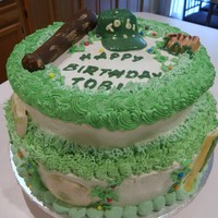 Sports Birthday Cake Chantilly cream frosting vanilla cake. The Child loves green and is into sports. The bat is all chocolate.