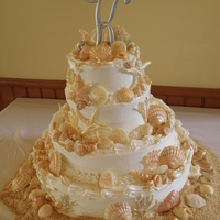 Seashell Wedding Cake All 171 shells and stars are Ghiradeli Chocolate which is individually painted. For 160 guest.