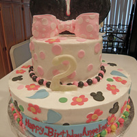 Minnie Mouse Cake Minnie Mouse Cake, Butter cream frosting with fondant decor, fondant covered Rice Crispy Treat Ears and Chantilly filling