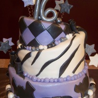 Sweet 16 Topsy Turvy (Halloween Themed) Birthday Cake The 3 layers of cake were white with buttercream filling, covered and decorated in fondant. (The bottom layer was Halloween themed with...