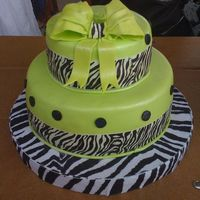Lime Green & Zebra Cake This would be my 6th Fondant (MMF) 2 tier cake. I made the bow :)