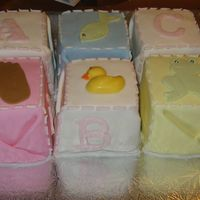 "Baby Block Cake I got the idea from Martha Stewart Baby Block cake, but she said to just cut a sheet pan cake into 2.5"" squares which would have been..."