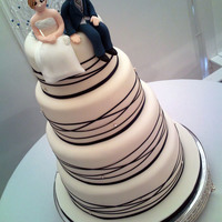 White And Midnight Blue Ribbon Wrapped Cake With Diamantes And Figures This is my first wedding cake of more than 2 tiers that was for someone other than myself! It is decorated in Ivory fondant and midnight...